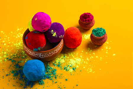 Celebrate indian festival holi, Multicolors ball on yellow background