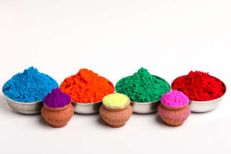 Indian festival Holi , Multi color's bowl on white background