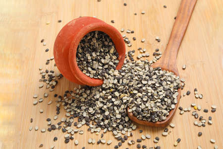 Split Black Lentil Also Know as Black Gram, Black Urad Dal, Vigna Mungo, Urad Bean on wooden background.