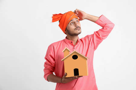 Home loan concept. Indian farmer posing on white background. Standard-Bild