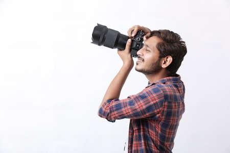 Photographer With Camera on white background. Stockfoto