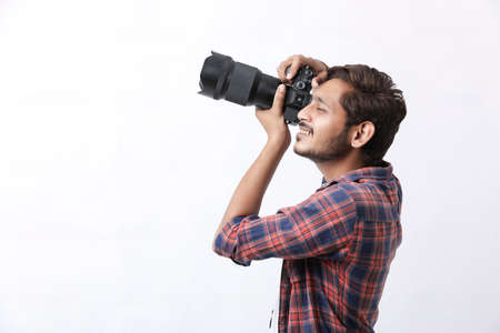 Photographer With Camera on white background. Banco de Imagens