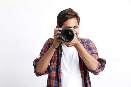 Photographer With Camera on white background. Reklamní fotografie