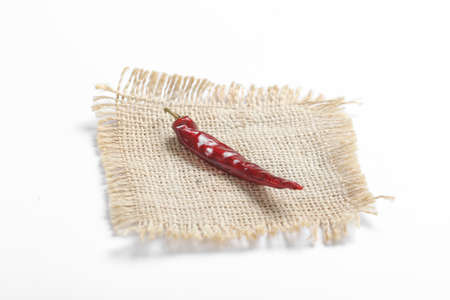 Dried red chilli on white background.