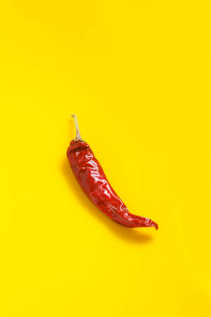 Dry Red chilli on yellow background.