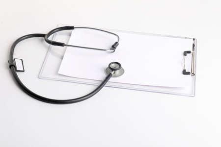 Black stethoscope lying on the diary, medicine. Stockfoto