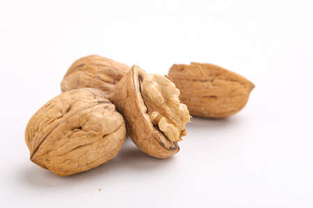 Walnuts and cracked walnut, isolated on white Stockfoto