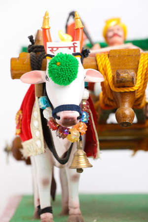 Traditional Indian wooden bull cart and statue of farmer sitting on bull cart