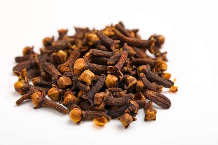 Spice cloves on white background.
