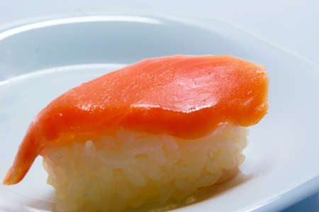 grasp: Part of the salmon Nigiri Sushi