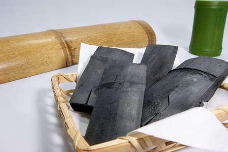 Bamboo and bamboo charcoal Imagens