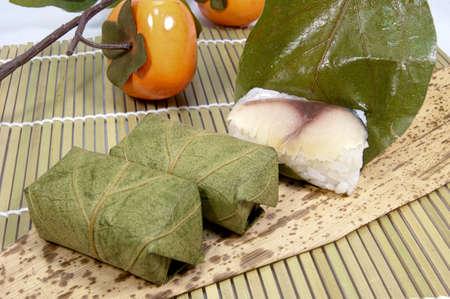 Persimmon leaf sushi Standard-Bild
