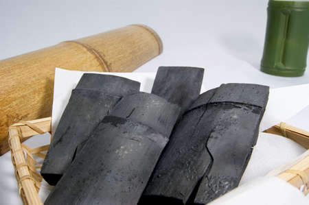 phlegm: Bamboo charcoal in a bamboo basket Stock Photo