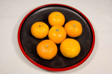 lacquerware: Japanese oranges on red lacquerware Stock Photo