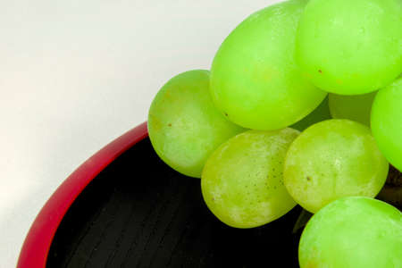 lacquer ware: Japans green Muscat placed on a red lacquer ware Stock Photo