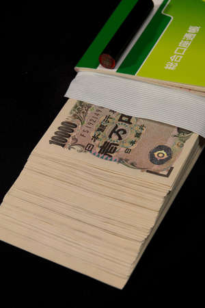 Savings passbooks and cash Banco de Imagens