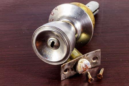 door knobs: Door Knobs on wood Background Stock Photo