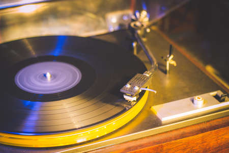 Close up at vintage gramophone. playing old song,Vintage record player with vinyl disc Reklamní fotografie - 82187580