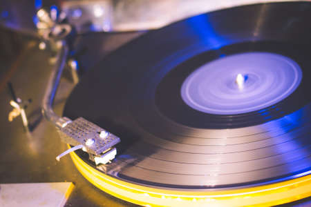 Close up at vintage gramophone. playing old song,Vintage record player with vinyl disc