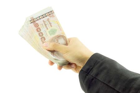 hand holding money isolated on white background. Stock Photo
