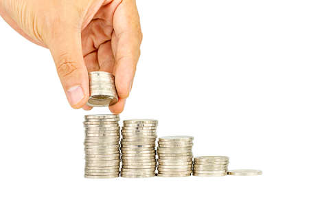 rate: Saving money concept,Male hand putting money coin stack growing business Stock Photo