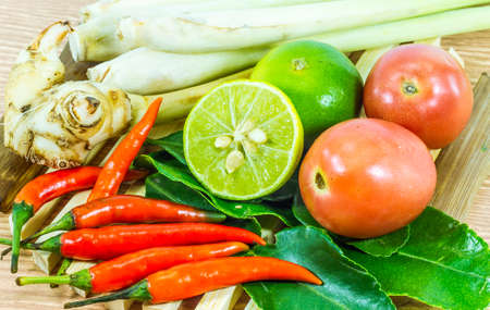 Various vegetables and seasoning cooking ingredients Tom Yum Soup or River Prawn Spicy Sour Soup (Tom Yum Goong) on  wooden background,Healthy eating and diet food concept.  Stock Photo