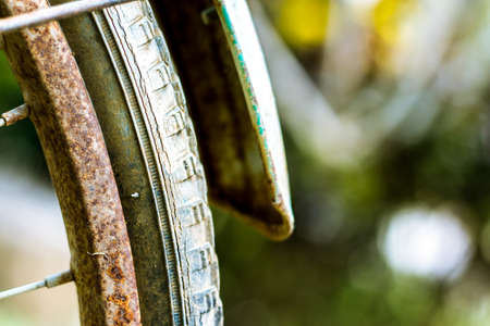 Close up of old rusty chain from the bicycle on background nature ,Bicycles detail view of wheel with old chain, sprocket,dirty chain (Vintage tone)