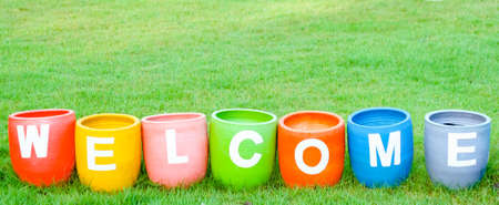 meet and greet: Welcoming and greetings concept with welcome word colorful on garden backgroun
