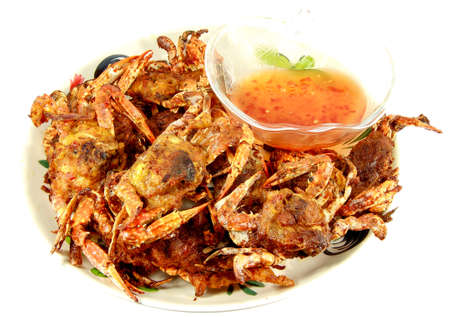 Crabs.Hot Steamed Crabs on a plate isolated on white background,Serrated mud crab, business people group in the line catering buffet food indoor in luxury restaurant  and seafood