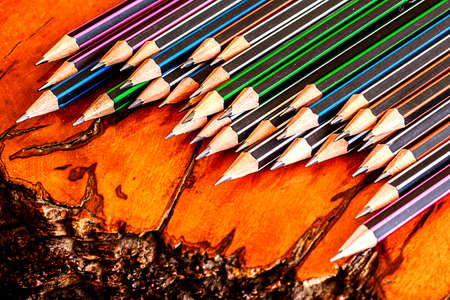 Pencils on wooden background. Stock Photo