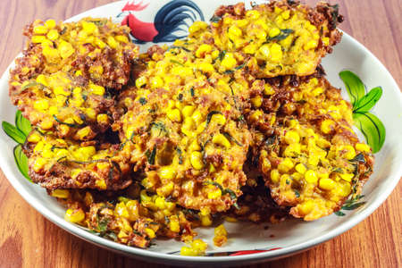 Deep fried ote-ote, Indonesian traditional snack made from corn, carrot, flour and shrimp