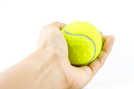 beautiful hands holding tennis ball Stock Photo