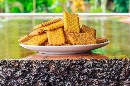 sesame cracker: sugar crackers biscuit on wooden plates