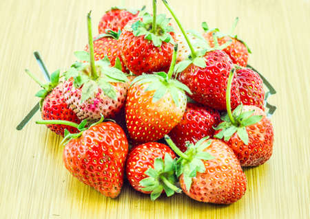 Heap of fresh ripe strawberries on wooden table on blurred wooden background,Close up Reklamní fotografie
