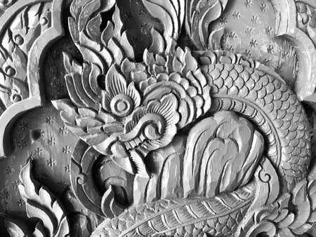 Pattern art processing of sculpture image carvings on wood background. Thai style carved wooden door detail, Close up,black and white Reklamní fotografie