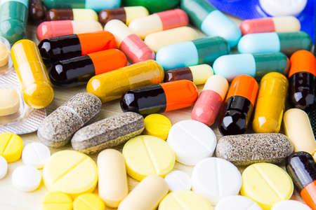 Medicine pills or capsules on wood background. Drug prescription for treatment medication.