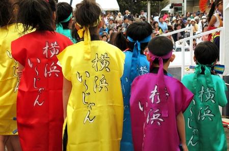 YOKOHAMA, JAPAN - OCTOBER 20, 2012: Dancers and unidentified child prepare to dance in annual festival in Shin-Yokohama ward.