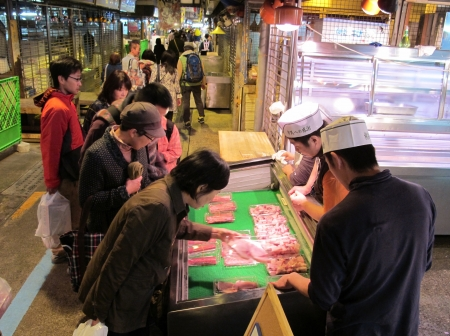 YOKOHAMA,JAPAN - OCTOBER 28, 2012: Tourists visit Yokohama fish market. It is the biggest fish market in Yokohama.