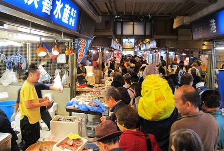 YOKOHAMA,JAPAN - OCTOBER 28, 2012: Tourists visit Yokohama fish market. It is the biggest fish market in Yokohama. Stock Photo - 17262282
