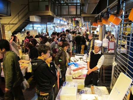 YOKOHAMA,JAPAN - OCTOBER 28, 2012: Tourists visit Yokohama fish market. It is the biggest fish market in Yokohama. Stock Photo - 17262293