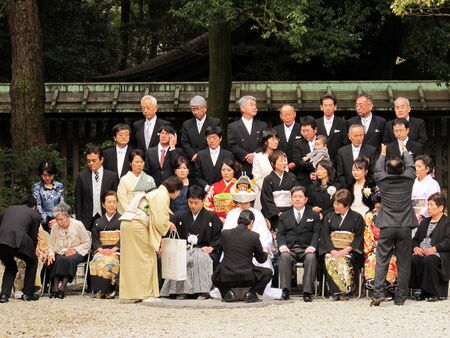 HARAJUKU,TOKYO - MARCH 25, 2012: Celebration of a typical wedding ceremony in Meiji Jingu Shrine Harajuku Tokyo, Japan.