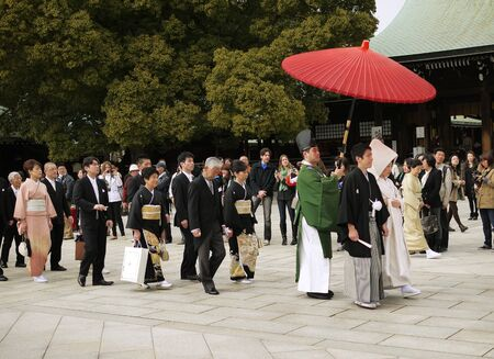 harajuku: HARAJUKU,TOKYO - MARCH 25, 2012: Celebration of a typical wedding ceremony in Meiji Jingu Shrine Harajuku Tokyo, Japan.
