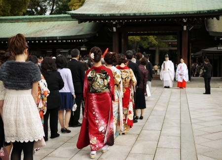 HARAJUKU,TOKYO - MARCH 25, 2012: Celebration of a typical wedding ceremony in Meiji Jingu Shrine Harajuku Tokyo, Japan.