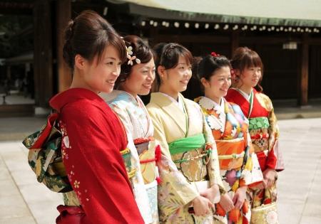 harajuku: HARAJUKU,TOKYO - MARCH 25, 2012: Unidentified women dressed in kimono in a celebration of a typical wedding ceremony in Meiji Jingu Shrine Harajuku Tokyo, Japan.