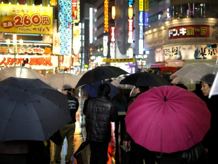 SHINJUKU,TOKYO MARCH 23, 2012: Rainny night in Shinjuku. It is an entertainment and night live district in Tokyo, Japan.