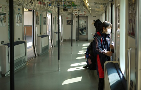 TOKYO - MARCH 28, 2012: Unidentified child on a train goes to school in the morning in Tokyo Japan.