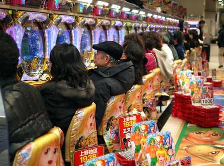 TOKYO - MARCH 29, 2012: Unidentified customers play slot machines in Tokyo, Japan.Slot machine- the most popular adult gambling in Japan.