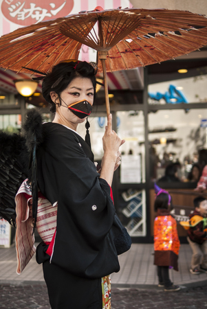 KAWASAKI,JAPAN - OCTOBER 27: The spectacular costumed attendee in the most annual amazing Halloween parade in Japan with 3000 attendees on October 27,2013 in Kawasaki city.