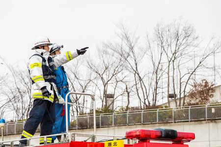 Kanagawa, Japan - January 5  The fire fighters on the rescue car perform fire fighting show in the New Year Editorial