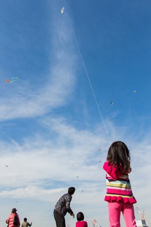 Kanagawa, Japan - January 13  Unidentified children fly Kites in the New Year